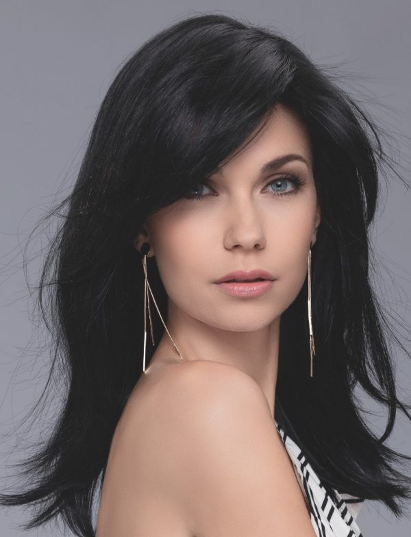 Wig model looking sideways wearing a long black wig.