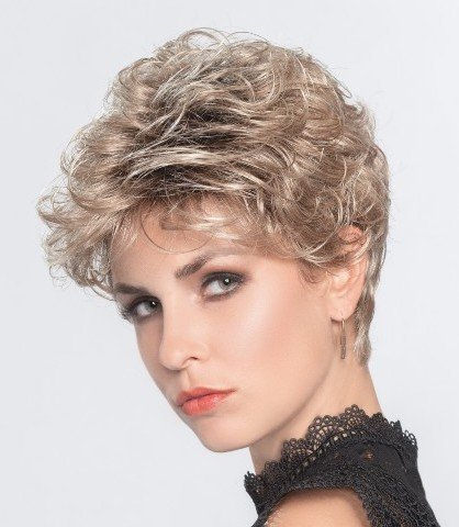 LOUISE is a short wavy wig with subtle lift and volume.